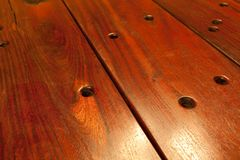 Wooden Table. Close-up of Brown wooden sleeper table with holes Stock Photography