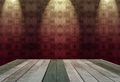 Wooden table with abstract background in dark room illuminated b Royalty Free Stock Photos