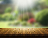 Wooden table and abstract blur landscape Royalty Free Stock Photography