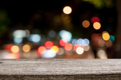 Wooden table with abstract bokeh Royalty Free Stock Image