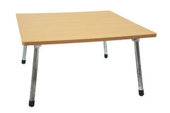 Wooden table with adjustable grunge metal legs Stock Photo