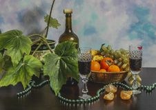 Two glasses and a bottle of wine with fruits on wooden table with red beads Royalty Free Stock Photos