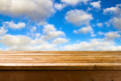 Wooden table against blue sky Stock Photo