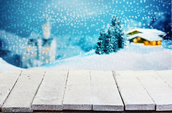 Wooden table against a winter Christmas scene Royalty Free Stock Photography