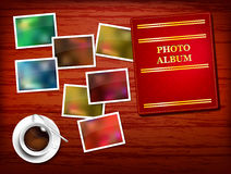 Wooden table, album, photos, coffee Royalty Free Stock Images