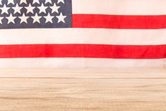 Wooden table and American flag in the background. Selective focus.  stock images