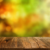 Wooden table with autumn background Stock Images