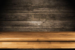 Wooden table background. Wooden table on dark background Royalty Free Stock Photography