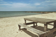 Wooden table on the beach Stock Images