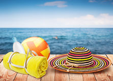 Wooden table with beach items Royalty Free Stock Photos