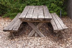 Wooden table and bench in the forest for picnic.  stock photos