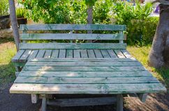 Wooden table with bench green gray in nature royalty free stock photos