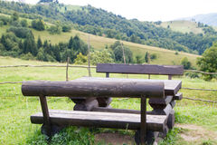 Wooden table and benches in the mountains Royalty Free Stock Images