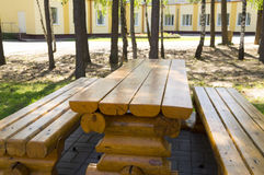 Wooden table and benches in the park Stock Image