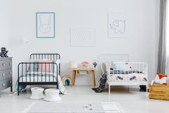 Free Wooden Table Between Black And White Bed In Children Bedroom Int Stock Photography - 118424952