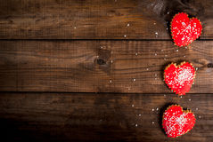 Wooden table, 3 biscuits valentine Stock Image
