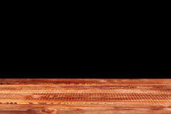 Wooden table on black background Stock Image