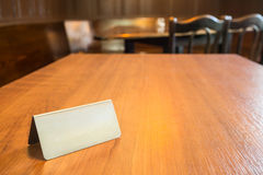 A wooden table and a blank steel plate on it Stock Photo
