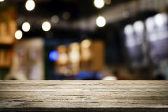 Wooden table with blur background of coffee shop stock images