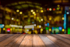 Wooden table with blur bokeh background Royalty Free Stock Images