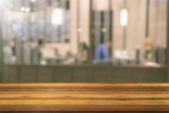 Wooden table with blur restaurant background Royalty Free Stock Images