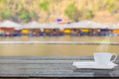 Wooden table with blure background of resort on river Stock Images