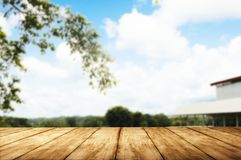 Wooden table with blurred blue sky and autumn trees royalty free stock images