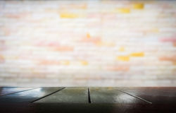 Wooden table with blurred of cement wall royalty free stock photography