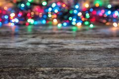 Wooden table and blurred Christmas lights background. Wooden table and blurred Christmas lights on background stock photos