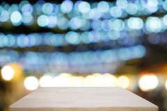 Wooden table with blurred of lights in the party. royalty free stock image