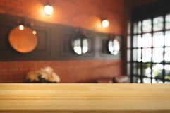 Wooden table with blurred modern home background stock image