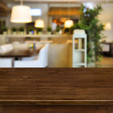 Wooden table on blurred room interior background.  stock photography