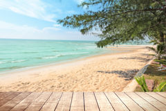 Wooden table with blurry tropical sea and resort background. Stock Images