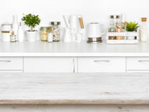 Wooden table with bokeh image of different kitchen common products Stock Photo