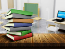 Wooden table and books with defocussed classroom image Royalty Free Stock Photography