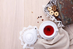 Wooden table for breakfast with teapot cup of tea and biscuits Royalty Free Stock Photography