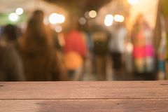 Wooden table of brown on front blurred night street background. Stock Image