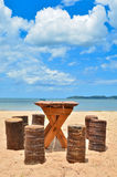 Wooden table and chair on beautiful beach Royalty Free Stock Photography