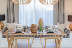 Wooden table and chair in modern dinning room Stock Images