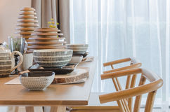 Wooden table and chair in modern dinning room Stock Photos
