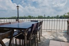 Wooden table and chair outdoor at Riverside Stock Images