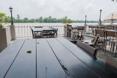 Wooden table and chair outdoor at Riverside Stock Photography