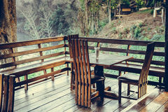Wooden table and chair in resort and garden, dining set at woode Royalty Free Stock Photos