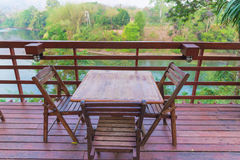 Wooden table and chair in resort and garden, dining set at woode Royalty Free Stock Photo
