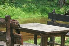 Wooden table and chair of the summer river. Close up Wooden table and chair of the summer river stock photography