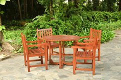 Wooden Table and chairs. In a lush garden Royalty Free Stock Photography