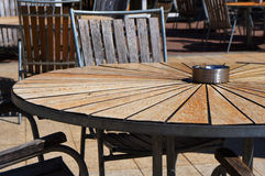 Wooden table and chairs in beach cafe. Royalty Free Stock Photos