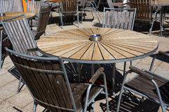 Wooden table and chairs in beach cafe. Royalty Free Stock Photo