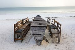 Wooden table and chairs on the beach. Furniture for lounging on royalty free stock photo