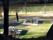 Wooden table and chairs in a campsite. To eat royalty free stock photography